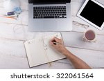 notebook on a white table with... | Shutterstock . vector #322061564