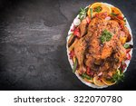 golden rustic and stuffed roast ... | Shutterstock . vector #322070780