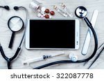 tablet pc with medical objects... | Shutterstock . vector #322087778