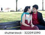 a young and happy indian couple ... | Shutterstock . vector #322091090