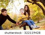 happy family having fun on a... | Shutterstock . vector #322119428