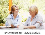 elderly woman sitting in the... | Shutterstock . vector #322136528
