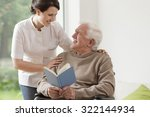 Photo Of Elderly Man Reading...
