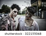 Two Male Zombies Standing In...
