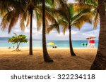 beach in jamaica with tall palm ...   Shutterstock . vector #322234118