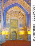 Small photo of SAMARKAND, UZBEKISTAN - APRIL 30, 2015: The magnificent mihrab in mosque of Tilya Kori Madrasah with blue and gilt painted patterns, on April 30 in Samarkand.