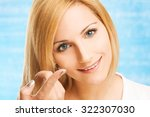 close up of a woman inserting... | Shutterstock . vector #322307030