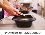 man puts mobile phone into tray ... | Shutterstock . vector #322320830