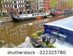 Old House Boats Along One Of...