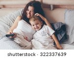young mother with her 2 years... | Shutterstock . vector #322337639