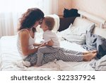 young mother with her 2 years... | Shutterstock . vector #322337924