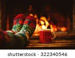 Feet in woollen socks by the...