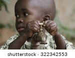 little black boy asking begging ... | Shutterstock . vector #322342553