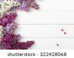 Stock photo the beautiful lilac on a wooden background 322428068