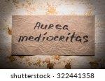 Small photo of popular metaphor in Latin. golden mean