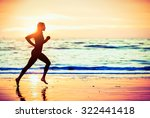 woman running on the beach at... | Shutterstock . vector #322441418