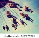 a swinging fair ride at dusk...   Shutterstock . vector #322476923