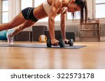 strong young woman doing push... | Shutterstock . vector #322573178