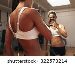 Sporty Young Woman Taking A...