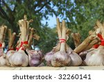 Garlic cloves at a farmers market in France, Europe - stock photo