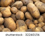 Raw potatoes at a farmers market, can be used as background - stock photo