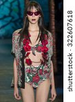 Small photo of New York City, USA - September 16, 2015: Issa Lish walks the runway at the Anna Sui fashion show during the Spring Summer 2016 New York Fashion Week at The Arc at Skylight Moynihan Station