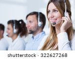 Small photo of Smiling customer service representative talking with client