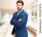 happy businessman smiling | Shutterstock . vector #322627676