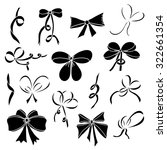 set of silhouettes of bows and... | Shutterstock .eps vector #322661354