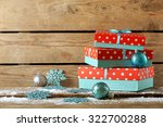 gift boxes on wooden background | Shutterstock . vector #322700288