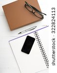 notepad with stack of book on... | Shutterstock . vector #322824113