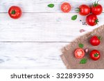 Tomatoes On A White Wooden...