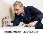 female plumber working on sink... | Shutterstock . vector #322966919