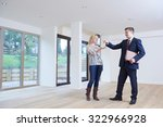 Small photo of Woman Collecting Keys To New Home From Estate Agent