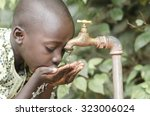 african black boy drinking... | Shutterstock . vector #323006024