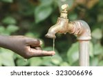 finger under water tap  water... | Shutterstock . vector #323006696