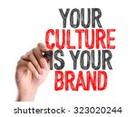 Small photo of Hand with marker writing: Your Culture Is Your Brand