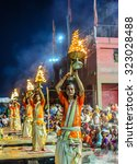 Small photo of VARANASI, INDIA-September 14 , 2015: A Hindu priest performs the Ganga Aarti ritual in Varanasi.Fire puja is a Hindu ritual that takes place at Dashashwamedh Ghat on the banks of the river Ganges