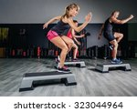 athletic woman trainer doing... | Shutterstock . vector #323044964