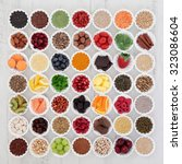 Small photo of Large superfood selection in porcelain crinkle bowls over distressed wooden background. High in vitamins and antioxidants.
