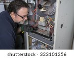 technician  looking over a gas... | Shutterstock . vector #323101256