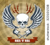 retro rock with skull wings and ... | Shutterstock . vector #323101538