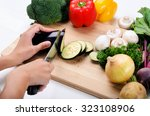 close up of hands slicing and... | Shutterstock . vector #323108906