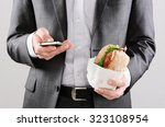 business man working on the go... | Shutterstock . vector #323108954