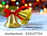 Golden Bells With Red Bow On A...