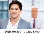 portrait of businessman with... | Shutterstock . vector #323225240