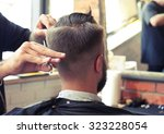 back view of man in barber shop.... | Shutterstock . vector #323228054
