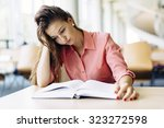 female student studying and... | Shutterstock . vector #323272598