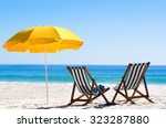 pair of sun loungers and a... | Shutterstock . vector #323287880