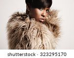 woman wearing jacket from a... | Shutterstock . vector #323295170